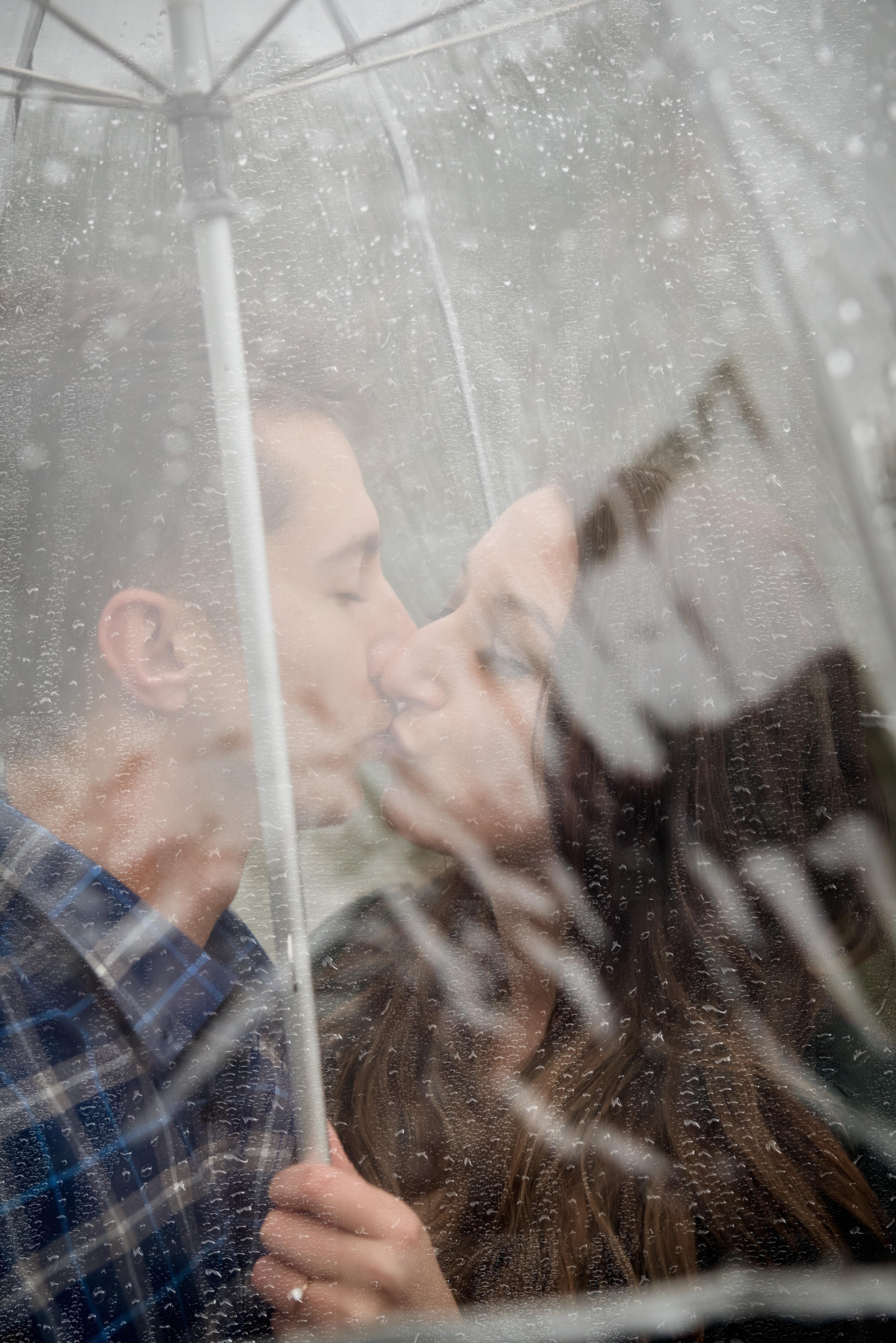 wet rainy day engagement photography in Athens, Ohio