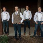 creative groomsmen photo with photographer in Athens Ohio