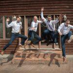 Creative groomsmen portrait jumping in Athens Ohio