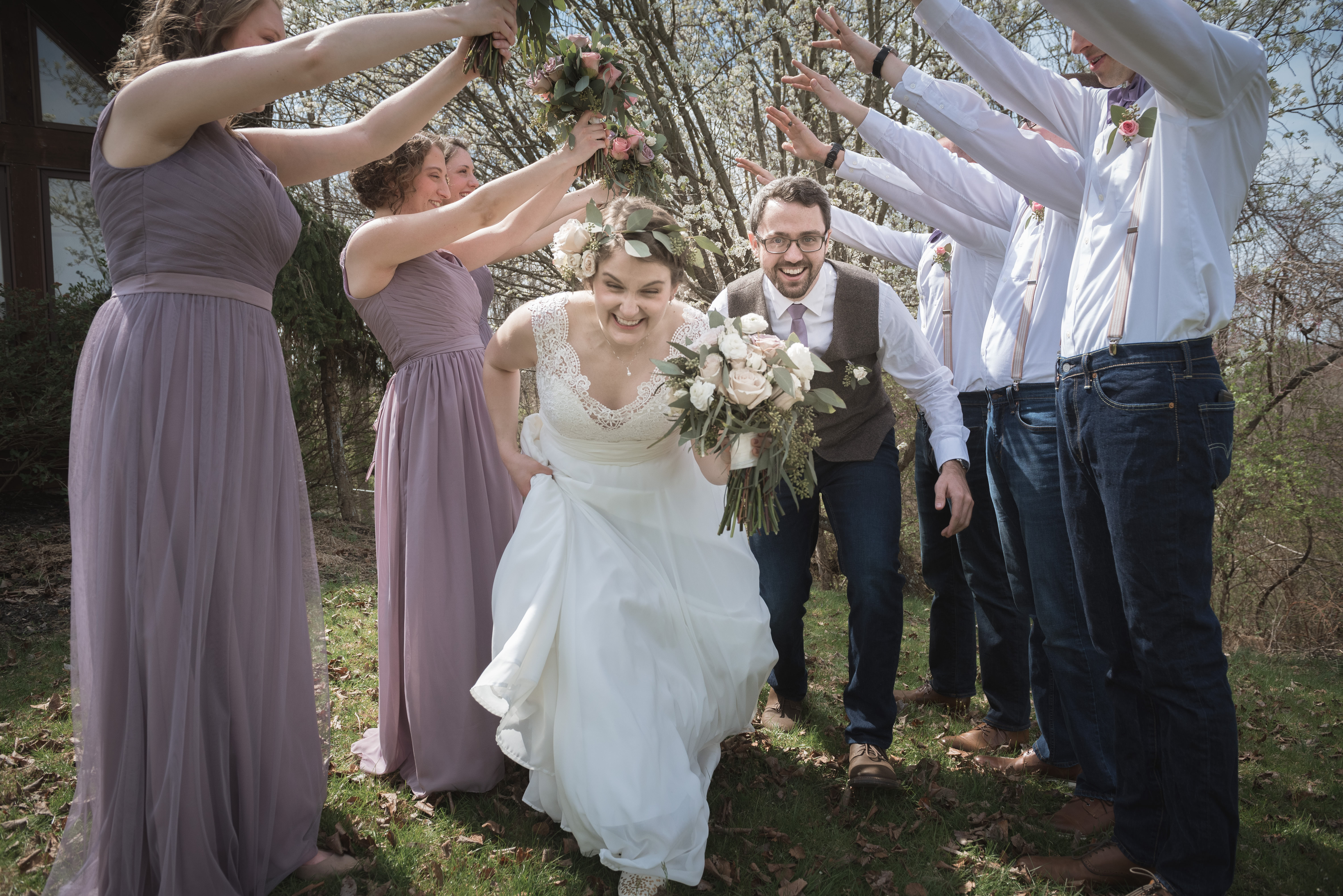 creative bride and groom portrait photography with wedding party in the spring in Athens Ohio