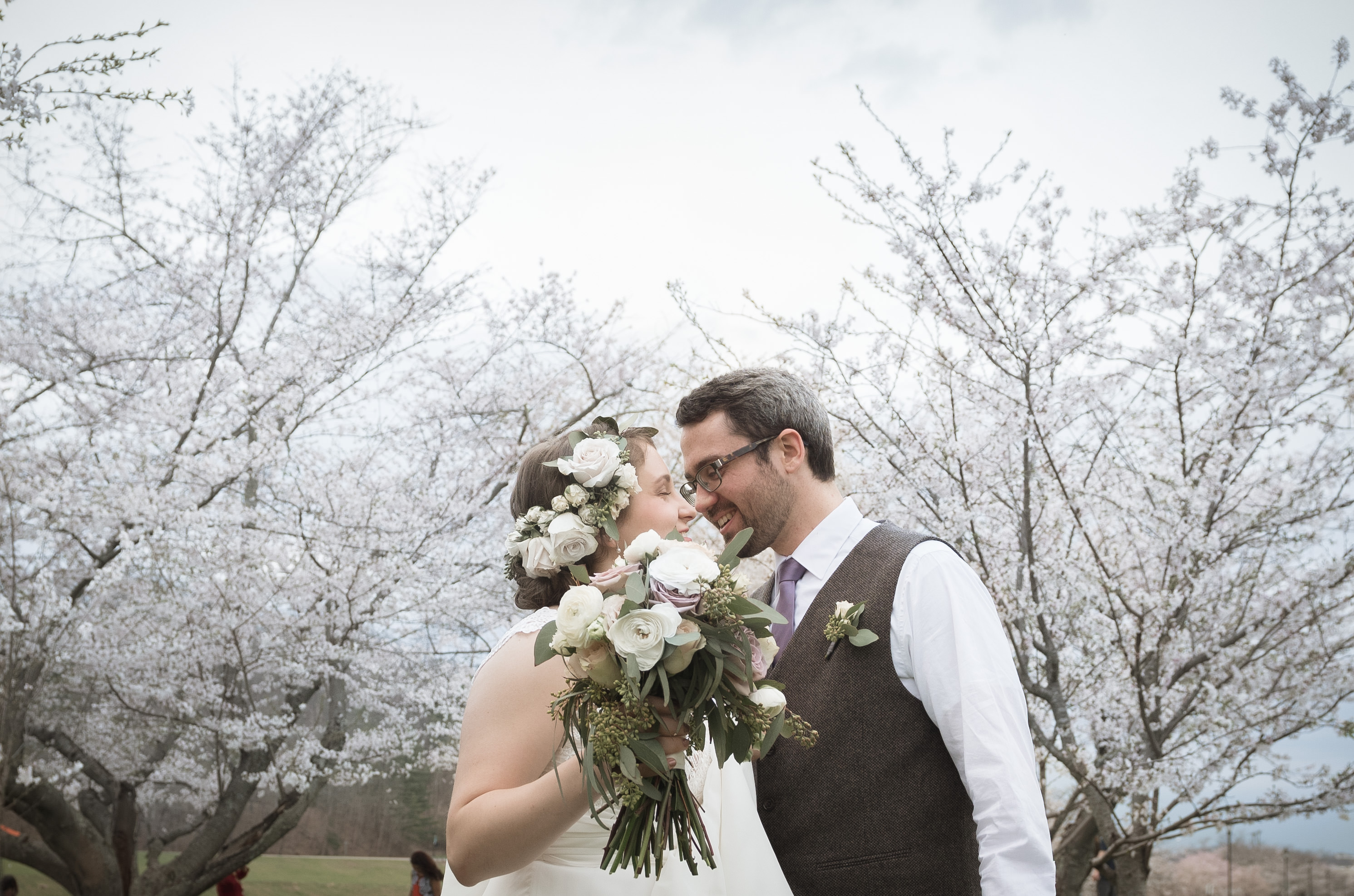 beautiful photography with bride and groom under cherry trees in athens ohio with photographer