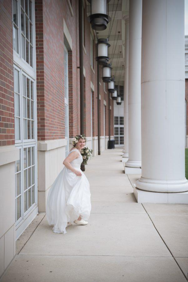 wedding with bride running in wedding dress at Walter Hall Ohio University