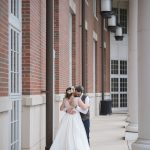 Brider and groom hug at Walter Hall at Ohio University in Athens