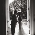 black and white photo of bride and groom standing in doorway of Galbreath Chapel at Ohio University in Athens