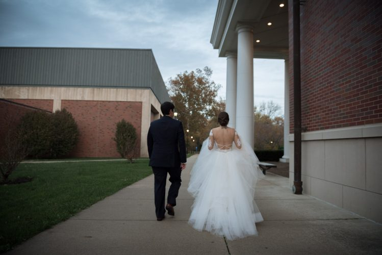 Bride and groom walking on campus at Ohio University in Athens Ohio