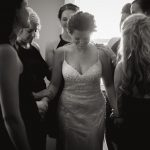 documentary approach to bridesmaids praying over bride before wedding in Granville ohio