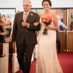 Bride and dad walking down aisle at Granville Chapel or New Hope Lutheran Church