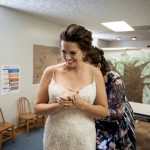 bride having white dress buttoned up at wedding in nashport ohio