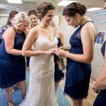 girls getting wedding dress on