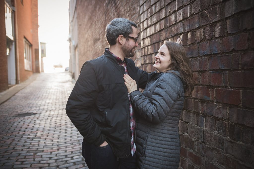 engagement session on court street in Athens Ohio in the winter