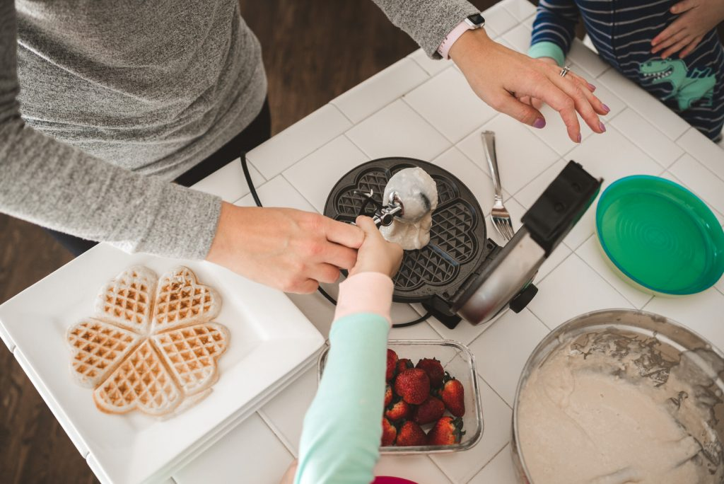 family morning making waffles documented with photographer