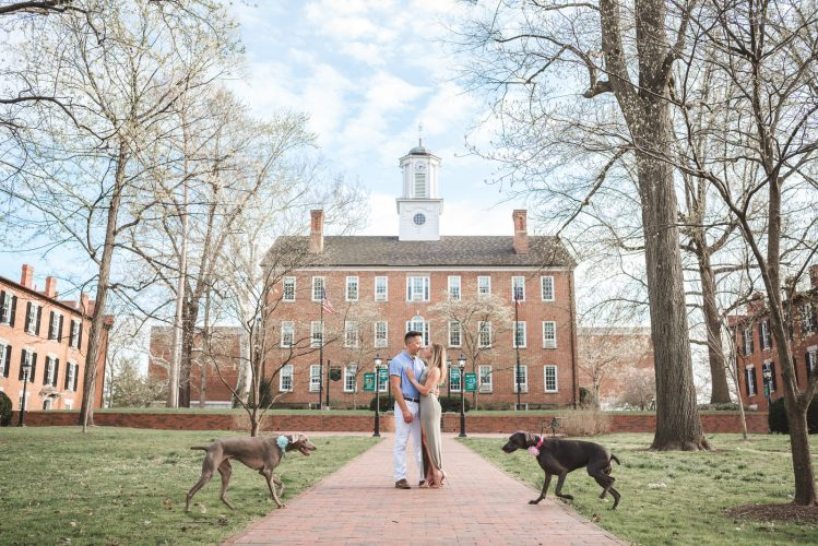 dogs and couple in front of culter hall at Ohio University in Athens
