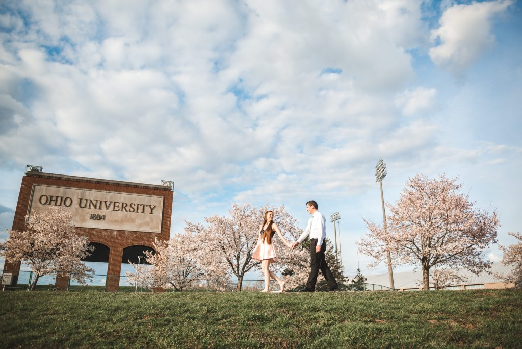 walking during engagement session at Ohio University with the best photographer