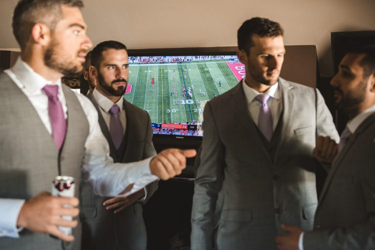 football game on at wedding